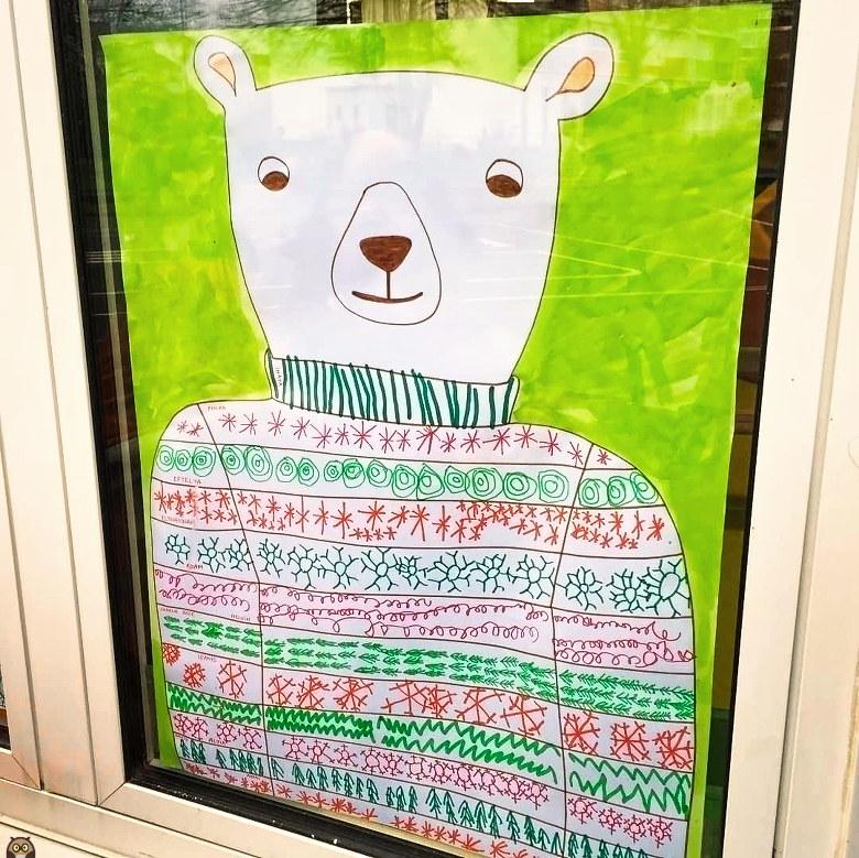 un ours polaire et son pull de Noël graphique
